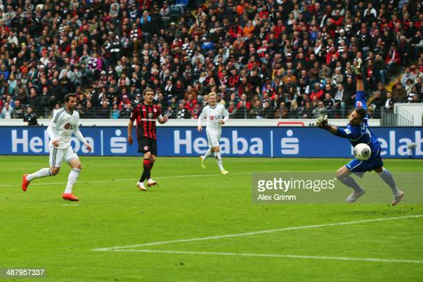 Gonzalo Castro of Leverkusen scores his team's first goal against goalkeeper Kevin Trapp of Frankfurt during the Bundesliga match between Eintracht...