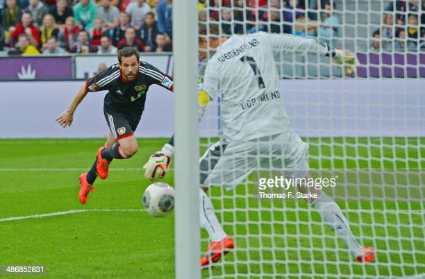 Gonzalo Castro of Leverkusen scores his teams second goal against goalkeeper Roman Weidenfeller of Dortmund during the Bundesliga match between Bayer...