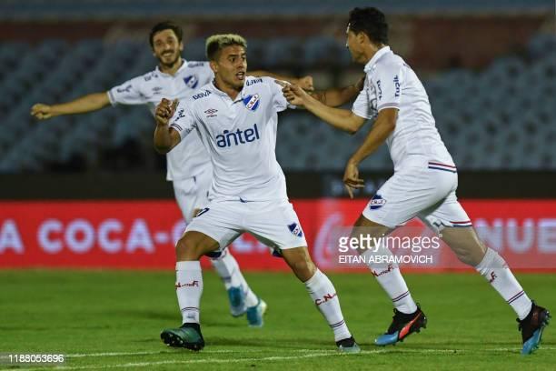 Gonzalo Castro of Nacional celebrates with teammate Felipe Carballo after scoring during the Uruguayan Clausura tournament final football match...