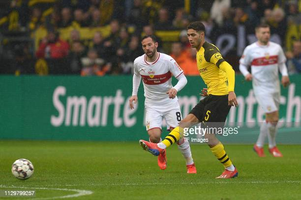 Gonzalo Castro of VfB Stuttgart and Achraf Hakimi of Borussia Dortmund battle for the ball during the Bundesliga match between Borussia Dortmund and...