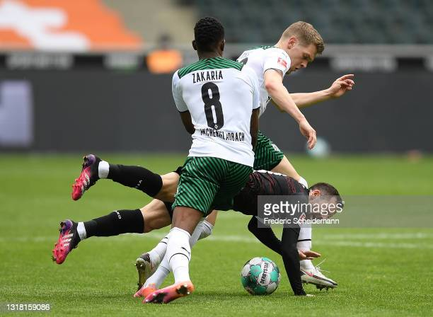 Gonzalo Castro of VfB Stuttgart battles for possession with Denis Zakaria and Matthias Ginter of Borussia Moenchengladbach during the Bundesliga...