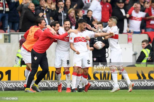 Gonzalo Castro of VfB Stuttgart celebrates with Nicolas Gonzalez of VfB Stuttgart and teammates after scoring his team's first goal during the...