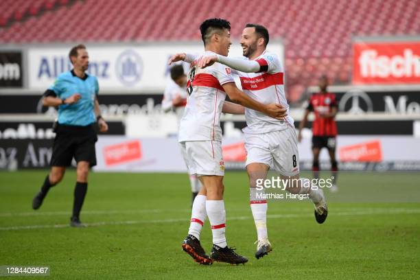 Gonzalo Castro of VfB Stuttgart celebrates with teammate Wataru Endo after scoring his team's second goal during the Bundesliga match between VfB...