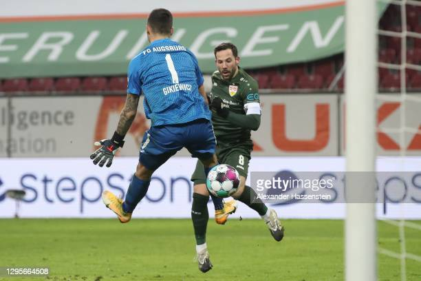 Gonzalo Castro of VfB Stuttgart scores their team's third goal past Rafal Gikiewicz of Augsburg during the Bundesliga match between FC Augsburg and...