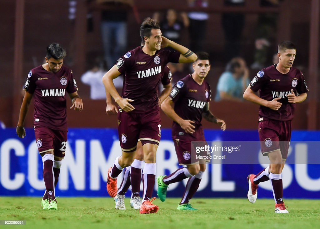 Gonzalo Di Renzo of Lanus celebrates with teammates after scoring the fourth goal of his team during a first leg match between Lanus and Sporting Cristal as part of first round of Copa CONMEBOL Sudamericana 2018 at Ciudad de Lanus Stadium on February 21, 2018 in Lanus, Argentina.