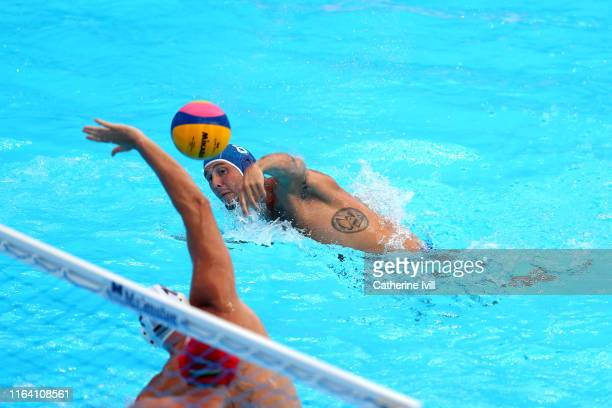 Gonzalo Echenique of Italy scores a goal against Hungary during the Men's Water Polo Semifinal match on day thirteen of the Gwangju 2019 FINA World...