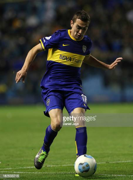 Gonzalo Escalante, of Boca Juniors drives the ball during a match between Boca Juniors and Quilmes as part of the Torneo Inicial 2013 at Alberto J...