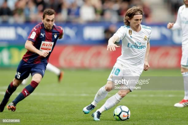 Gonzalo Escalante of SD Eibar Luka Modric of Real Madrid during the La Liga Santander match between Eibar v Real Madrid at the Estadio Municipal de...
