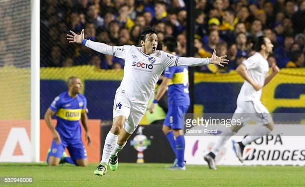 Gonzalo Fabian Porras of Nacional celebrates a Boca Junior's own goal by Daniel Diaz during a second leg match between Boca Juniors and Nacional as...
