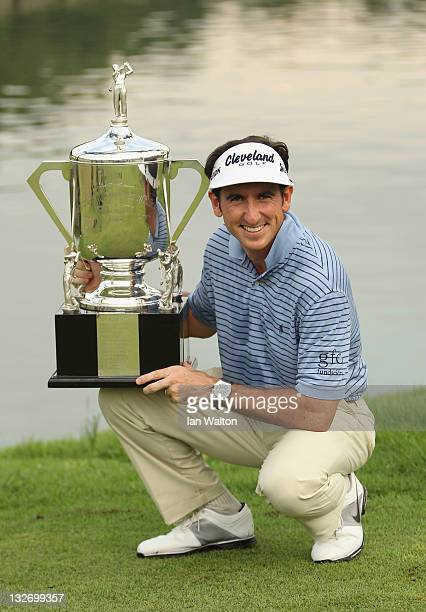 Gonzalo FernandezCastano of Spain celebrates with the trophy after winning the playoff on the 18th hole on day five of the Barclays Singapore Open at...