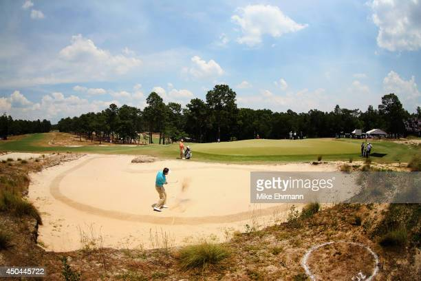 Gonzalo FernandezCastano of Spain hits a shot from a greenside bunker during a practice round prior to the start of the 114th US Open at Pinehurst...