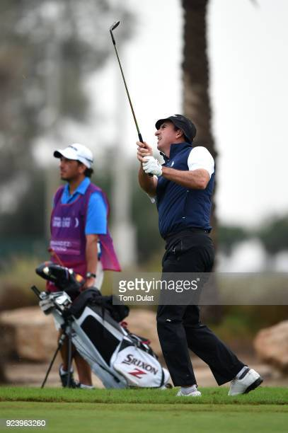 Gonzalo FernandezCastano of Spain hits an approach shot on the 1st hole during the final round of the Commercial Bank Qatar Masters at Doha Golf Club...
