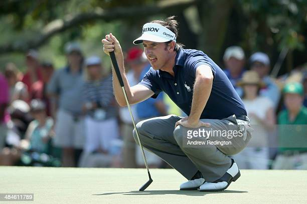 Gonzalo FernandezCastano of Spain lines up a putt on the first green during the final round of the 2014 Masters Tournament at Augusta National Golf...