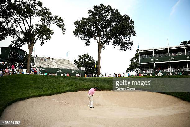 Gonzalo FernandezCastano of Spain plays his third shot from the bunker on the 17th hole during the first round of The Barclays at The Ridgewood...