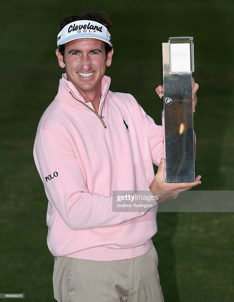 Gonzalo Fernandez-Castano of Spain poses with the trophy after wining the BMW Masters at Lake Malaren Golf Club on October 27, 2013 in Shanghai, China.