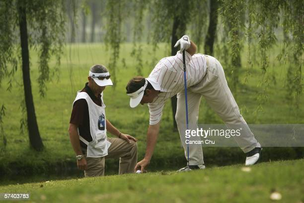 Gonzalo Fernandez-Castano of Spain takes a penalty drop at the 9th hole during the final round of the BMW Asian Open 2006 at Tomson Golf Club April...