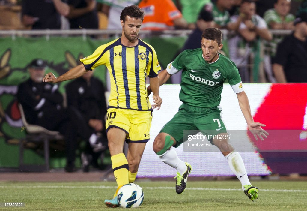 Gonzalo Garcia Garcia of Maccabi Tel-Aviv FC controls the ball watched by Gustavo Boccoli (R) of Maccabi Haifa FC during the Israeli Premier League match between Maccabi Haifa FC and Maccabi Tel-Aviv FC held on April 29, 2013 at the Kiryat Eliezer Stadium in Haifa, Israel.