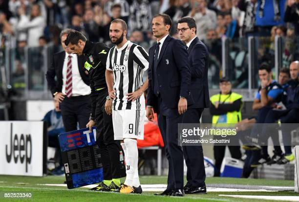 Gonzalo Gerardo Higuain of Juventus and Massimiliano Allegri head coach of Juventus during the Serie A match between Juventus and Torino FC on...