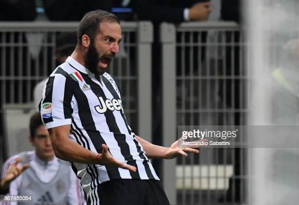 Gonzalo Gerardo Higuain of Juventus celebrates after scoring the opening goal during the Serie A match between AC Milan and Juventus at Stadio...