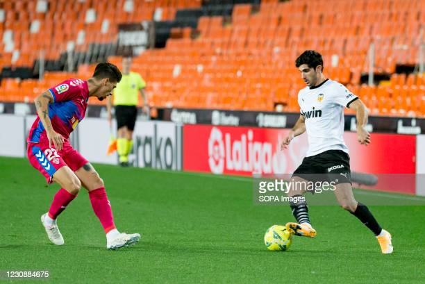 Gonzalo Guedes of Valencia and Emiliano Rigoni of Elche are seen in action during the Spanish La Liga football match between Valencia and Elche at...