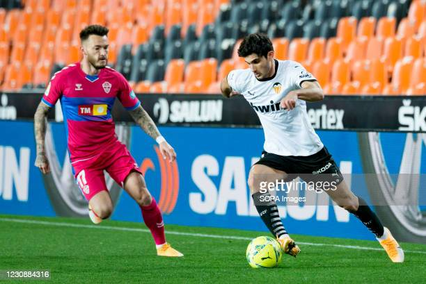 Gonzalo Guedes of Valencia and Jose Antonio Ferrandez Pomares of Elche are seen in action during the Spanish La Liga football match between Valencia...