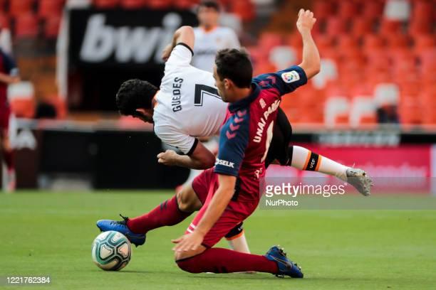 Gonzalo Guedes of Valencia CF and Unai Garcia of CA Osasuna during La Liga match between Valencia CF and CA Osasuna at Mestalla Stadium on June 21...