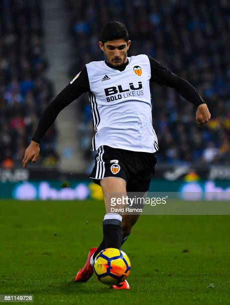 Gonzalo Guedes of Valencia CF runs with the ball during the La Liga match between Espanyol and Valencia at Cornella El Prat stadium on November 19...