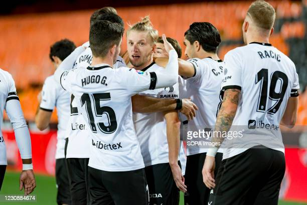 Gonzalo Guedes, Uros Racic, Daniel Wass and Hugo Guillamon of Valencia celebrating a goal during the Spanish La Liga football match between Valencia...