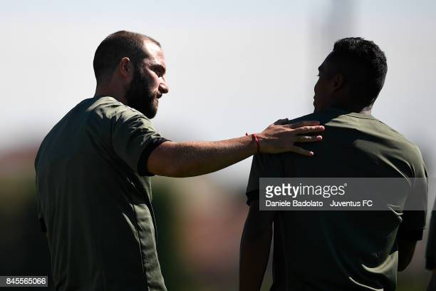 Gonzalo Higuain and Alex Sandro during a Juventus training session at Juventus Center Vinovo on September 11 2017 in Vinovo Italy