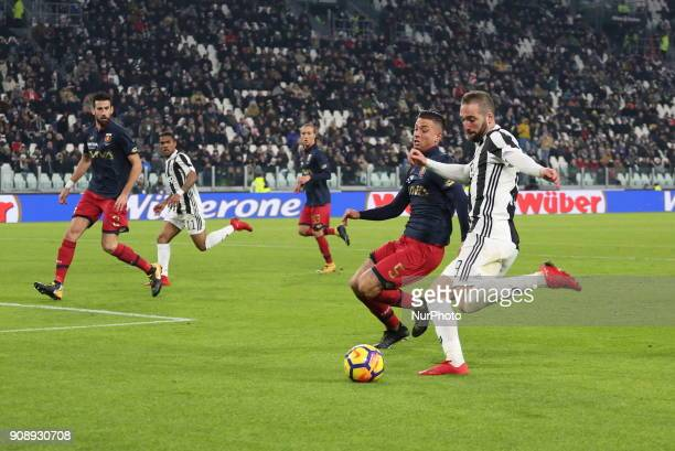Gonzalo Higuain and Armando Izzo compete for the ball during the Serie A football match between Juventus FC and Genoa CFC at Allianz Stadium on 22...