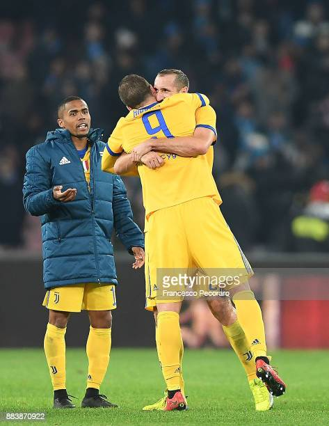 Gonzalo Higuain and Giorgio Chiellini players of Juventus celebrate the victory after the Serie A match between SSC Napoli and Juventus at Stadio San...