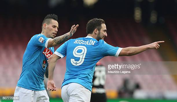 Gonzalo Higuain and MArek Hamsik of Napoli celebrate the equalizing goal during the Serie A match between SSC Napoli and Empoli FC at Stadio San...