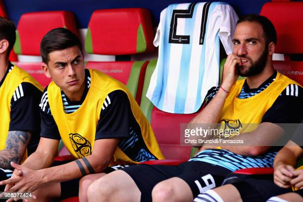Gonzalo Higuain and Paulo Dybala both of Argentina look on from the substitutes bench during the 2018 FIFA World Cup Russia Round of 16 match between...