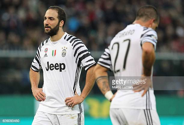 Gonzalo Higuain and Stefano Sturaro of Juventus FC show their dejection during the Serie A match between Genoa CFC and Juventus FC at Stadio Luigi...