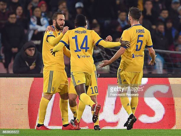Gonzalo Higuain Blaise Matuidi and Miralem Pjanic of Juventus celebrate the 01 goal scored by Gonzalo Higuain during the Serie A match between SSC...
