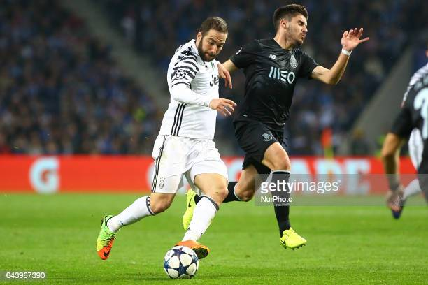 Gonzalo Higuain forward of Juventus FC vies with Porto's Portuguese midfielder Ruben Neves during the UEFA Champions League Round of 16 1st leg...