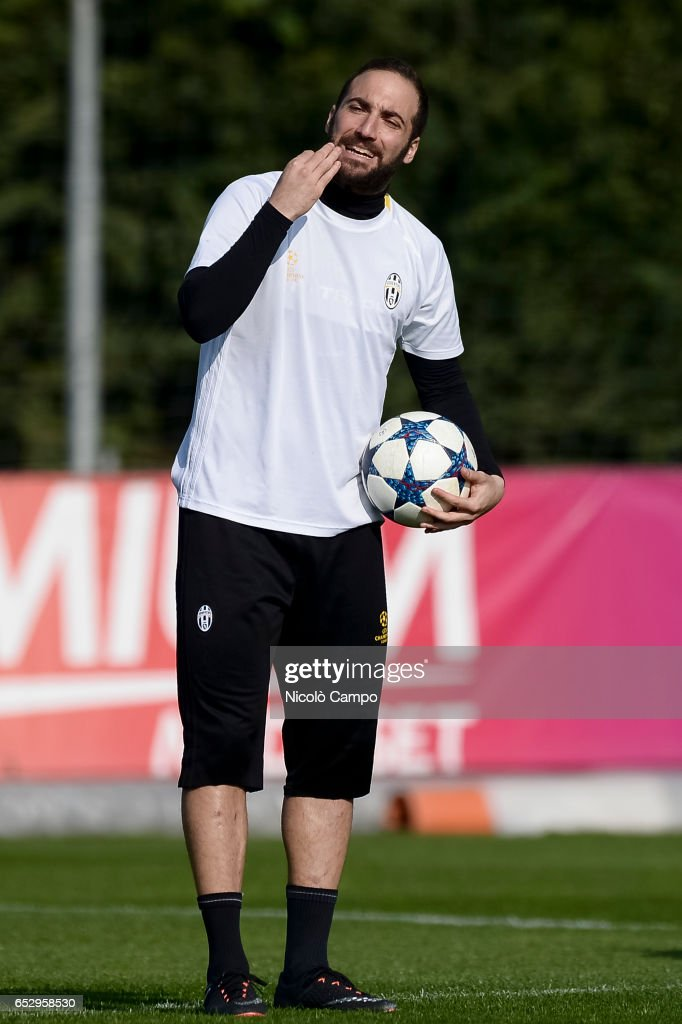 Gonzalo Higuain gestures during the Juventus FC training on...