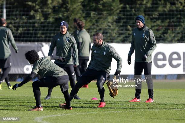 Gonzalo Higuain Juan Cuadrado and Gonzalo Higuain of Juventus FC during the Juventus FC training on the eve of the UEFA Champions League football...