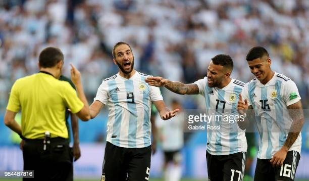 Gonzalo Higuain Nicolas Otamendi of Argentina and Marcos Rojo of Argentina argue with Referee Cuneyt Cakir during the 2018 FIFA World Cup Russia...