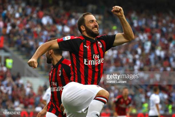 Gonzalo Higuain of AC Milan celebrates after scoring the opening goal during the Serie A match between AC Milan and Atalanta BC at Stadio Giuseppe...