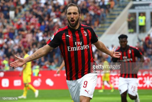 Gonzalo Higuain of AC Milan celebrates after scoring the opening goal during the Serie A match between AC Milan and Chievo Verona at Stadio Giuseppe...