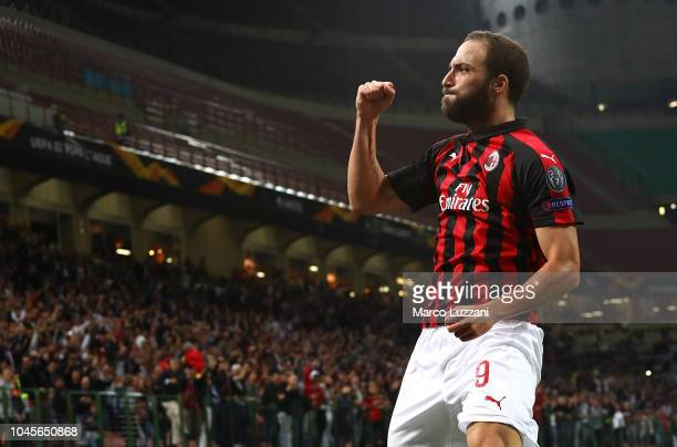 Gonzalo Higuain of AC Milan celebrates his goal during the UEFA Europa League Group F match between AC Milan and Olympiacos at Stadio Giuseppe Meazza...