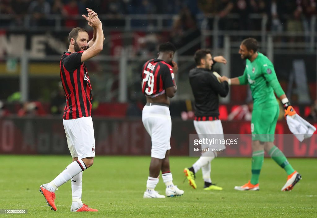 Gonzalo Higuain of AC Milan celebrates victory at the end of the serie A match between AC Milan and AS Roma at Stadio Giuseppe Meazza on August 31, 2018 in Milan, Italy.