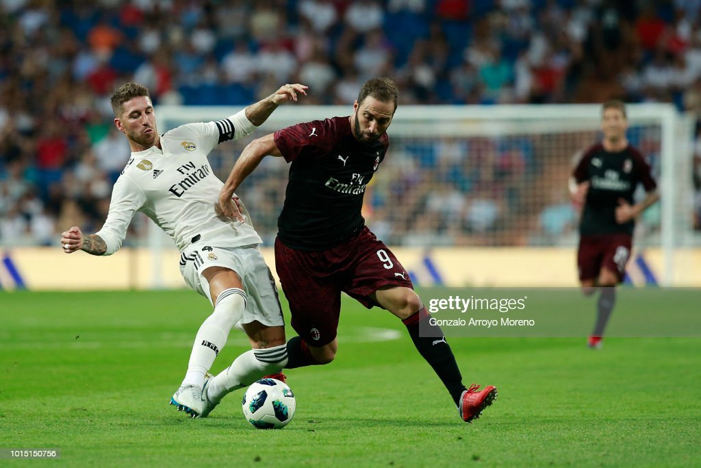 Gonzalo Higuain (R) of Ac Milan competes for the ball with Sergio Ramos (L) of Real Madrid CF during the Santiago Bernabeu Trophy between Real Madrid CF and AC Milan at Estadio Santiago Bernabeu on August 11, 2018 in Madrid, Spain.