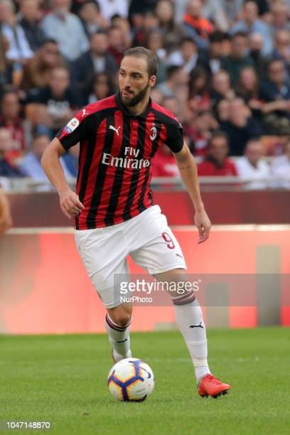 Gonzalo Higuain of AC Milan in action during the serie A match between AC Milan and Chievo Verona at Stadio Giuseppe Meazza on October 7 2018 in...
