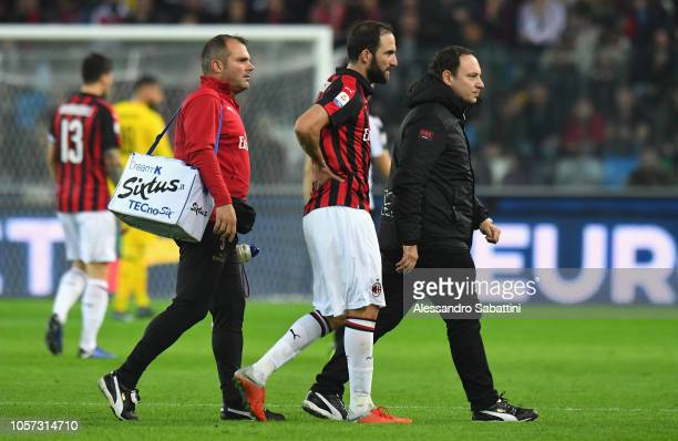 Gonzalo Higuain of AC Milan leaves the field after beinh injured during the Serie A match between Udinese and AC Milan at Stadio Friuli on November 4...