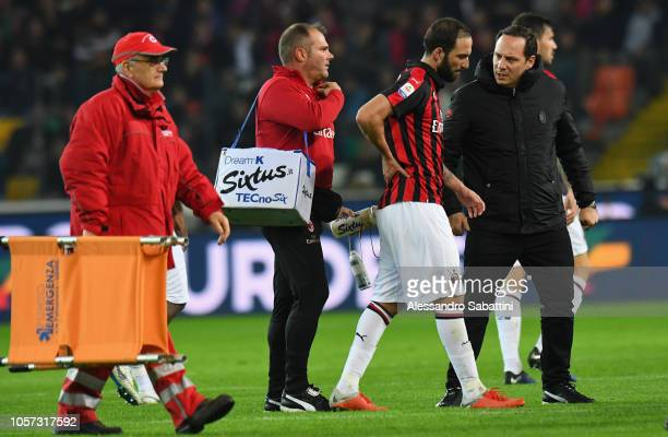 Gonzalo Higuain of AC Milan leaves the field injured during the Serie A match between Udinese and AC Milan at Stadio Friuli on November 4 2018 in...