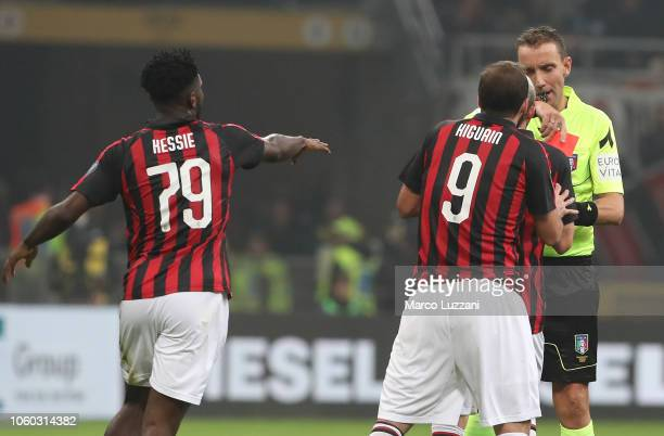 Gonzalo Higuain of AC Milan receives the red card from referee Paolo Silvio Mazzoleni during the Serie A match between AC Milan and Juventus at...