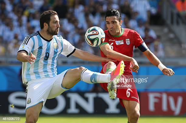 Gonzalo Higuain of Argentina and Javad Nekounam of Iran in action during the 2014 FIFA World Cup Brazil Group F match between Argentina and Iran at...