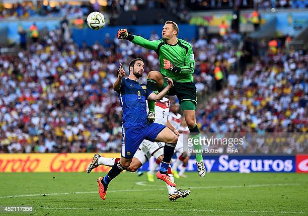 Gonzalo Higuain of Argentina and Manuel Neuer of Germany collide during the 2014 FIFA World Cup Brazil Final match between Germany and Argentina at...